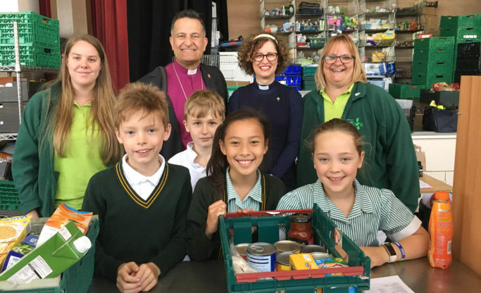 Bournemouth Foodbank staff, children and church leaders bishop
